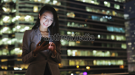 business woman sending text message on