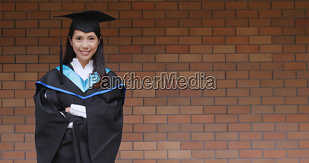 woman with graduation gown in university