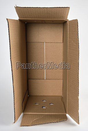 open brown paper box on white