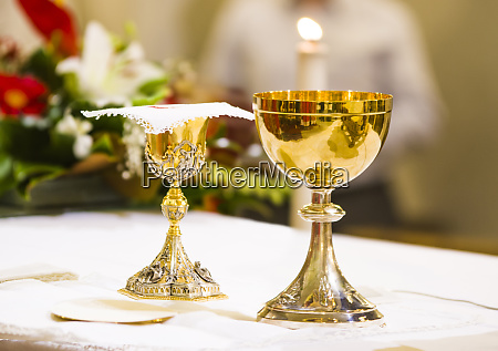 cup with wine and ciborium with