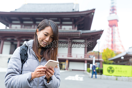 woman use of cellphone in tokyo