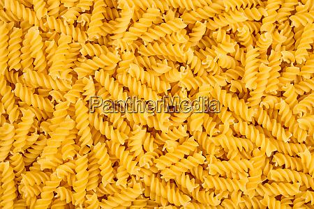 texture of raw spirelli noodles pasta