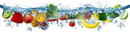 fresh multi fruits and vegetables splashing