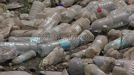 a river of pollution plastic bottles