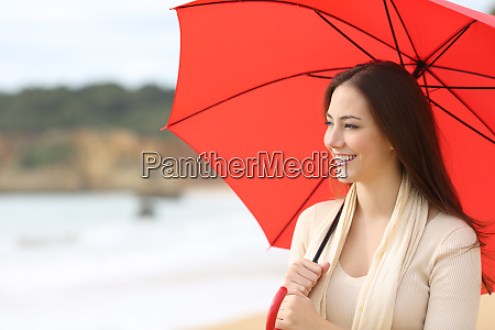 happy woman looks at side holding