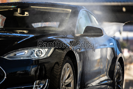 woman washing her car in a