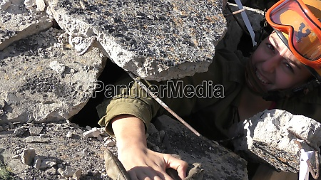 israeli homeland security soldier paramedic holds