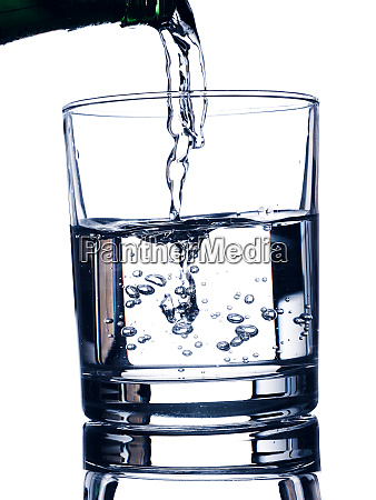 pouring fresh water in a glass