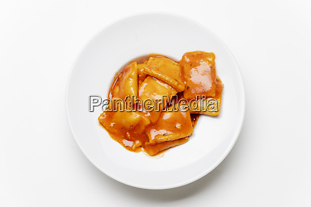 ravioli in a plate on white