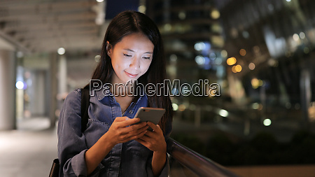 asian woman sms texting using app