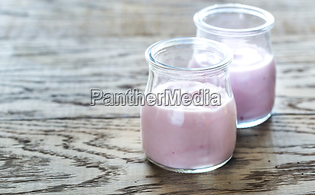 glass jars of berry yoghurts