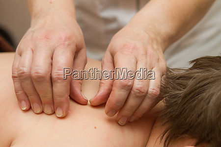 the masseur gives the child a