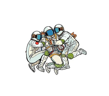 three astronauts hugging