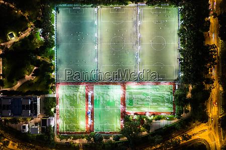 football and basketball court at night