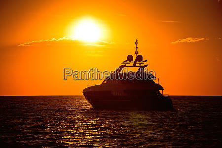 yachtig on open sea at golden