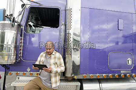 truck driver working on digital tablet