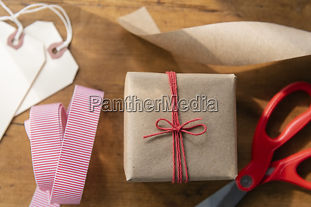 christmas present with ribbon and scissors