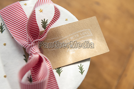 christmas present with ribbon and label