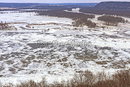frozen confluence of two midwest rivers