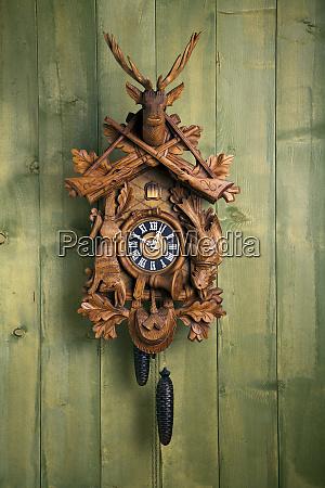 cuckoo clock in front of wooden
