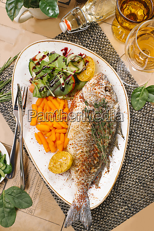fried fish with baby carrots and
