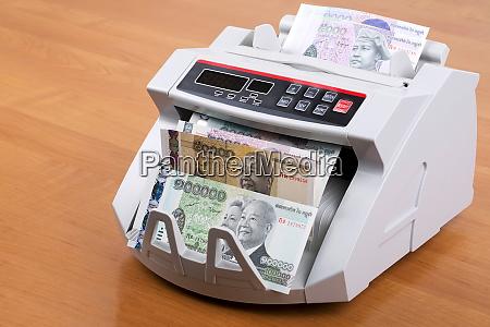 cambodian riel in a counting machine