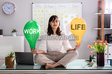 womans hand holding life and work
