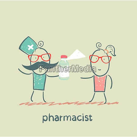pharmacist giving medicine to the patient