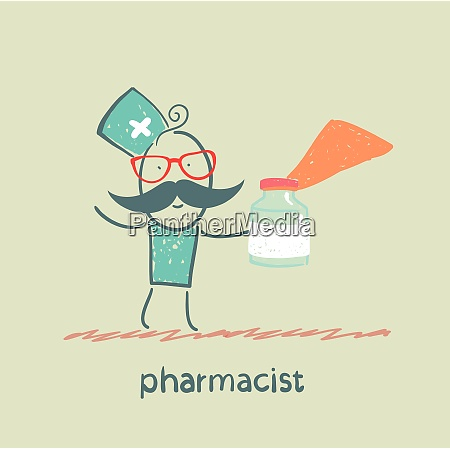 pharmacist holds a bottle with medicine