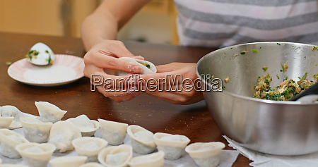 woman make with chinese meat dumpling