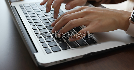 woman type on notebook computer