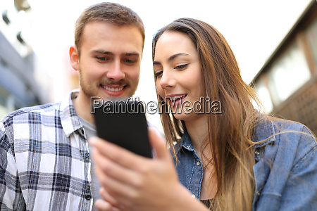 couple talking about smart phone online