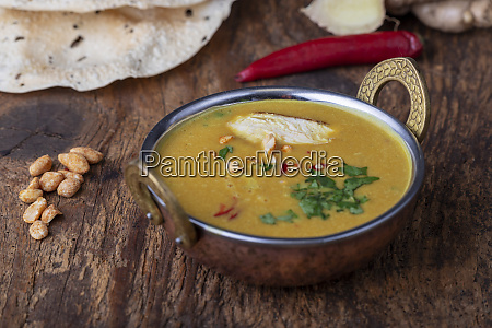 indian mulligatawny soup in a brass