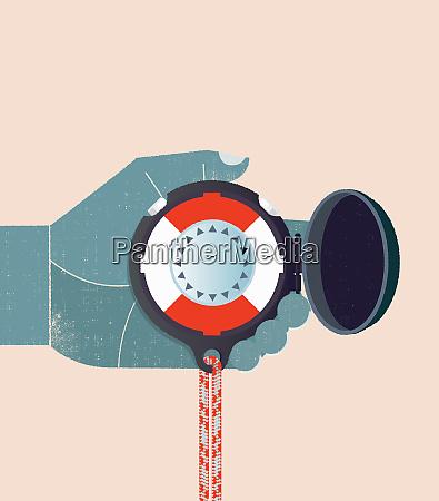 hand holding life belt compass