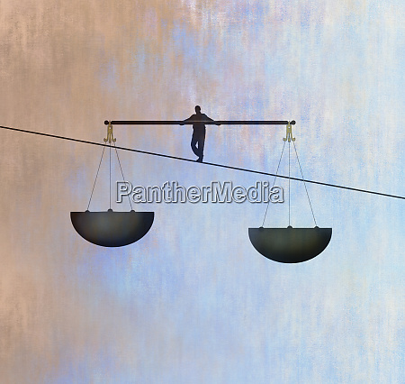 man walking tightrope using scales of