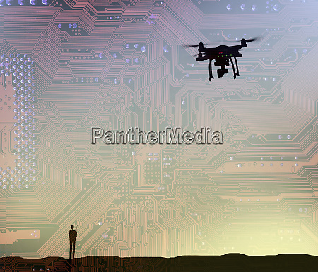 man flying drone in circuit board