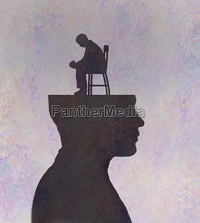 depressed man sitting inside of mans