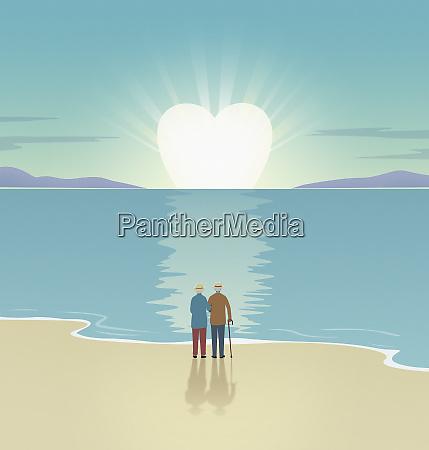 elderly couple watching heart shaped sun