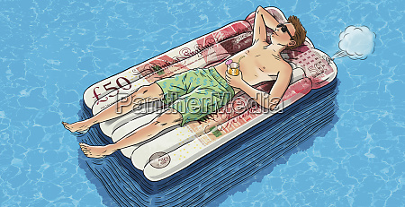 young man floating on money air