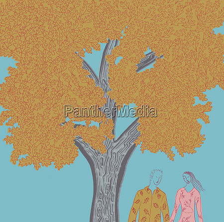 young couple holding hands under tree