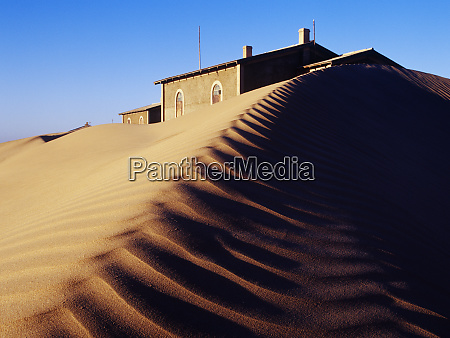 house buried in sand