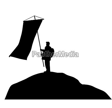 man standing on mountain top and