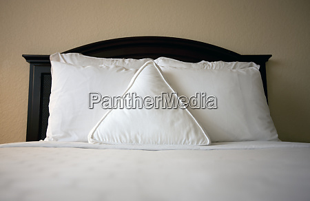 triangle pillow on bed