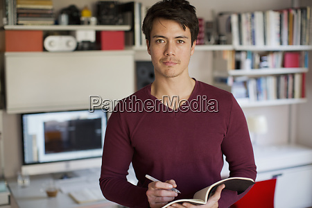 portrait confident man working in home