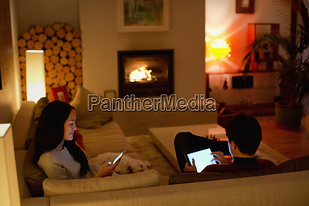 couple using digital tablet and smart