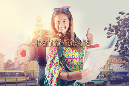 girl tourist with backpack and map