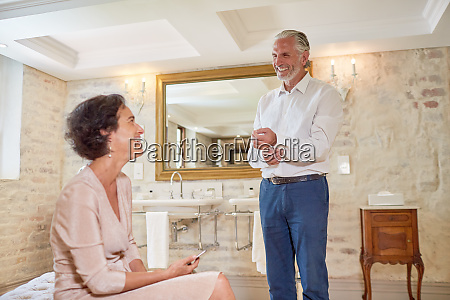 mature couple in luxury hotel bathroom