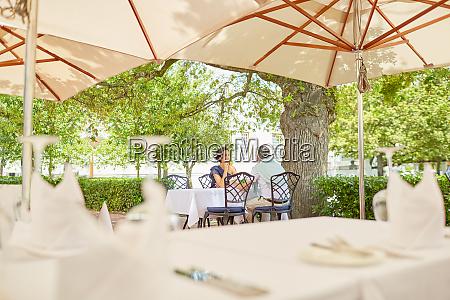 mature couple dining on resort patio