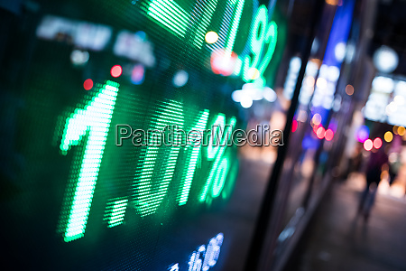 stock index numbers with city scene