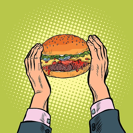 hands holding a burger fast food